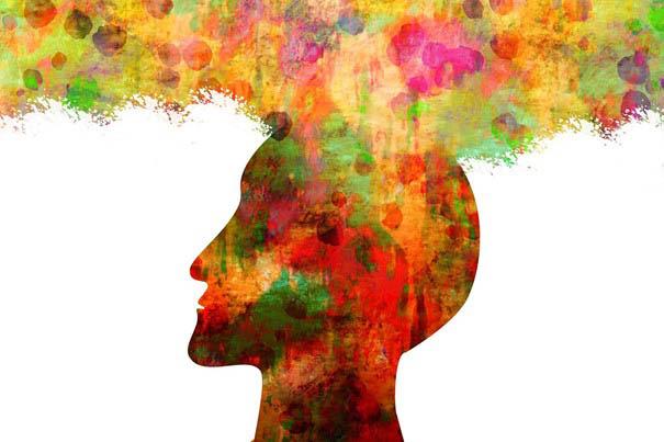 Bunter Kopf aus dem Farben strömen